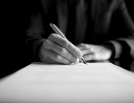 closeup-of-lawyer-or-executive-signing-a-contract-PK4B7831